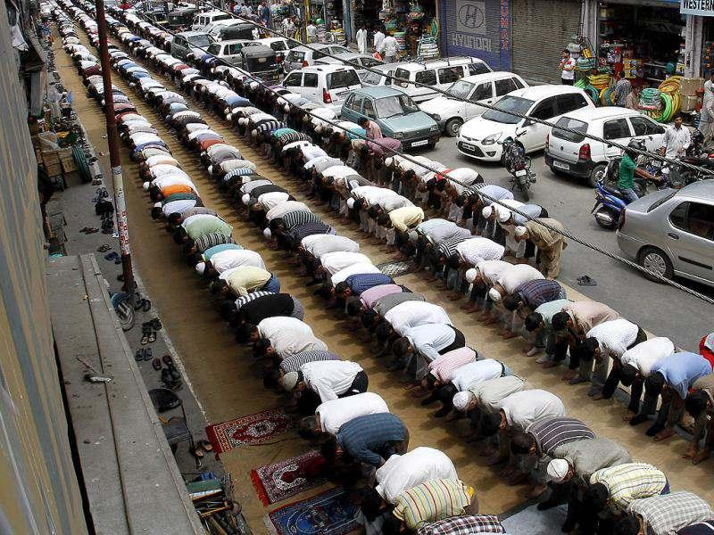 Kashmiri Muslims pray on a street on the first day of Ramadan, in Srinagar. Muslims throughout the world are marking the month of Ramadan, the holiest month in Islamic calendar where devout fast from dawn till dusk. (AP Photo)