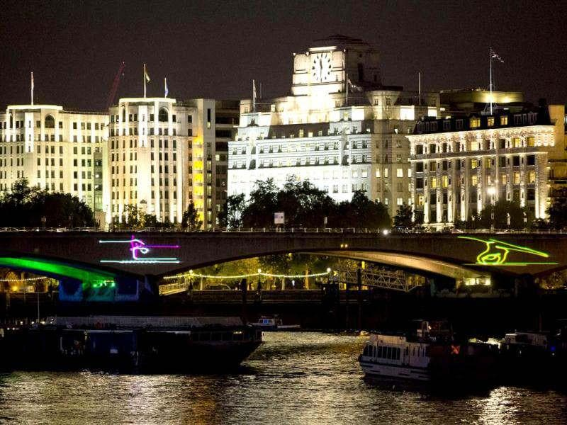 A view of Waterloo Bridge is seen as it is lit up with pictograms to celebrate the Olympics in London. (Reuters Photo/Neil Hall)