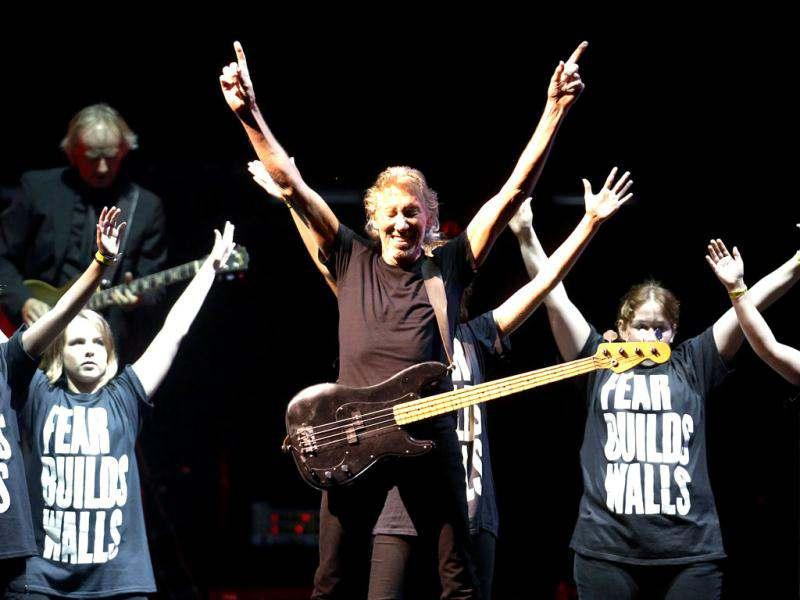 Pink Floyd co-founder and musician Roger Waters performs with children during the last show of his