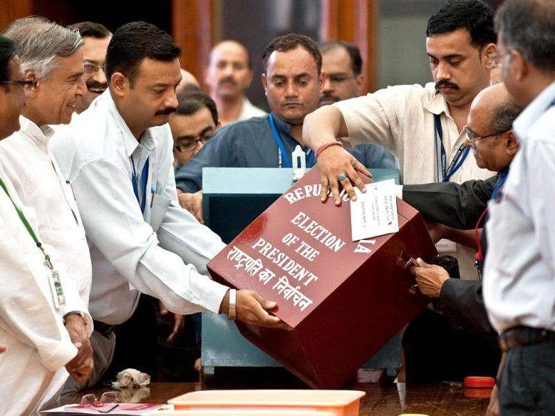 Election observers and officials take out a ballot box as they begin tallying the Presidential election results, at the Parliament in New Delhi. AFP/Prakash Singh