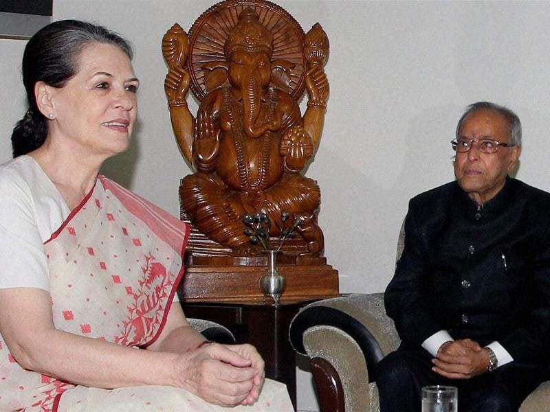 Newly elected President Pranab Mukherjee with UPA Chairperson Sonia Gandhi at his residence in New Delhi. PTI photo/Atul Yadav