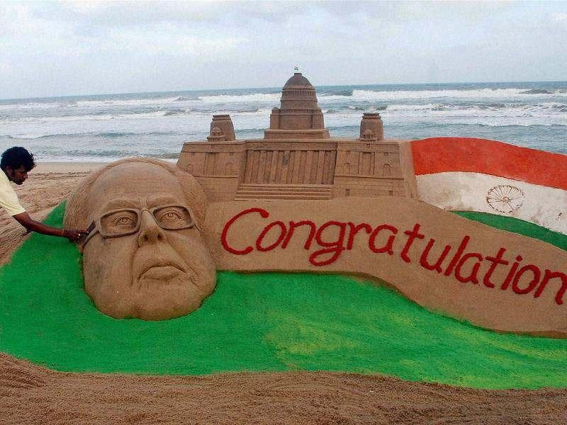A sand sculpture congratulating Pranab Mukherjee on his victory in the Presidential election, created by sand artist Sudarsan Pattnaik at the Puri beach in Orissa. PTI Photo