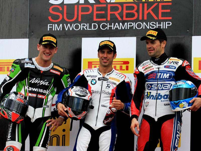 Italy's Marco Melandri who took first place, Great Britain's Tom Sykes who took second place and Spain's Carlos Checa who took third place pose after the second race of the Superbike World Championship in Brno. AFP/Radek Mica