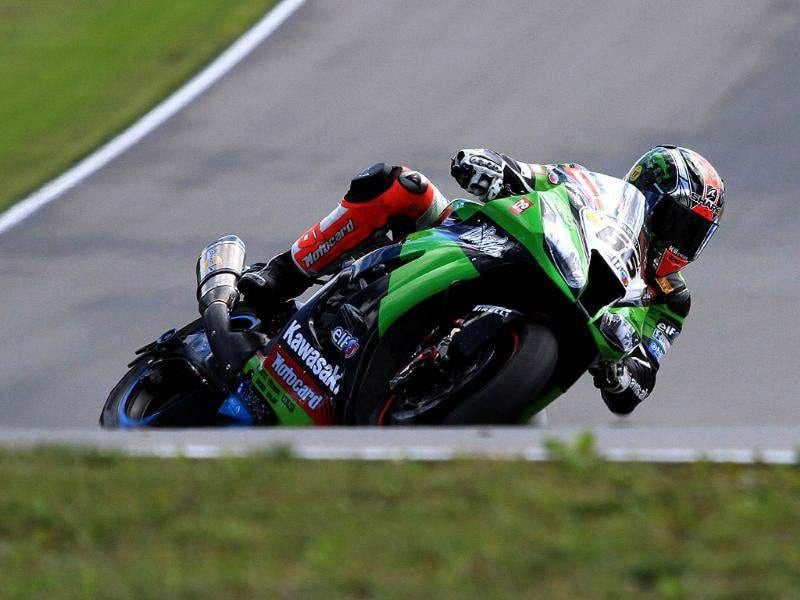 Great Britain's Tom sykes rides for second place during the first race of the Superbike World Championship in Brno. AFP/Radek Mica