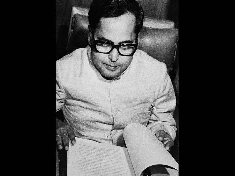 Pranab Mukherjee going through his papers during his stint as finance minister in 1983. HT file photo