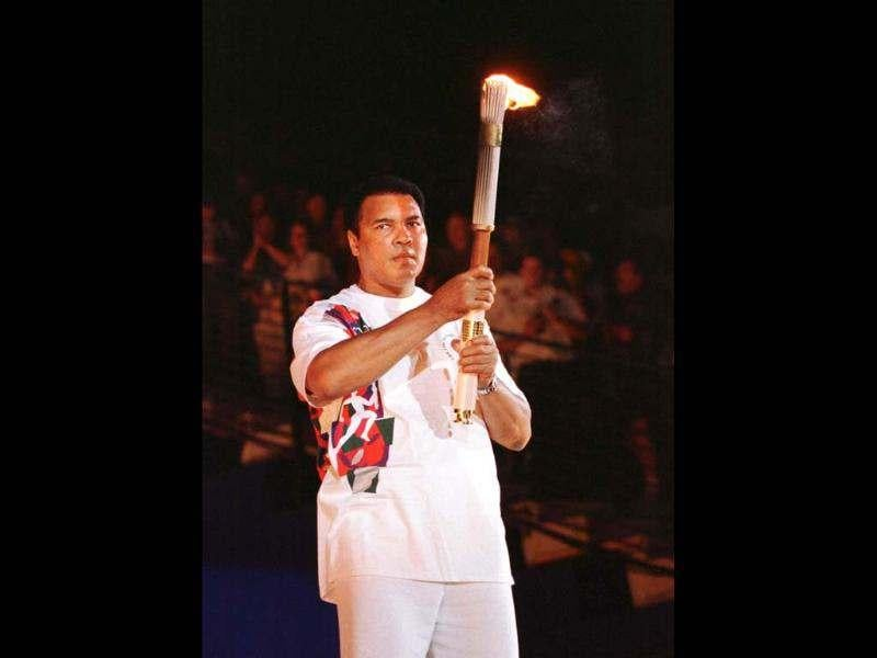 Former boxer Cassius Clay's impact on Rome 1960 is talked up because of the worldwide fame he later gained as Muhammad Ali. Here he holds up the torch during the opening ceremonies of the XXVI Centennial Olympic Games in Atlanta. Reuters/Andy Clark