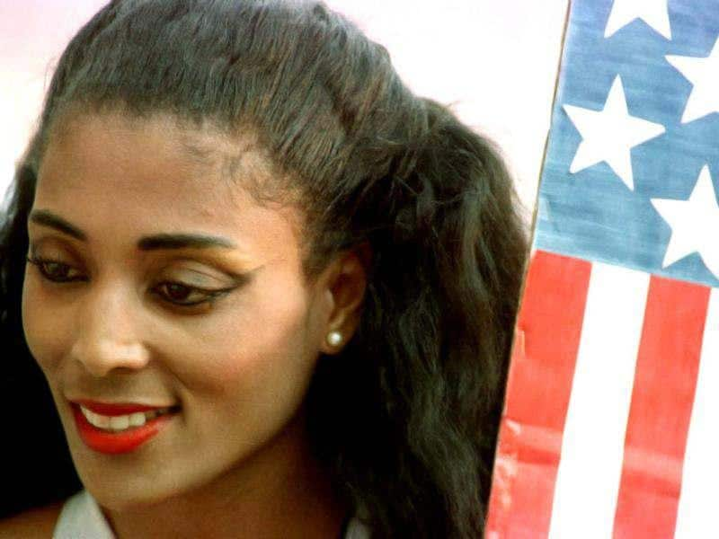 Florence Griffith Joyner poses next to an American flag at the 1988 Seoul Olympics. 'Flo Jo', who won three sprint gold medals at the Games, died of an apparent heart seizure. Gary Hershorn