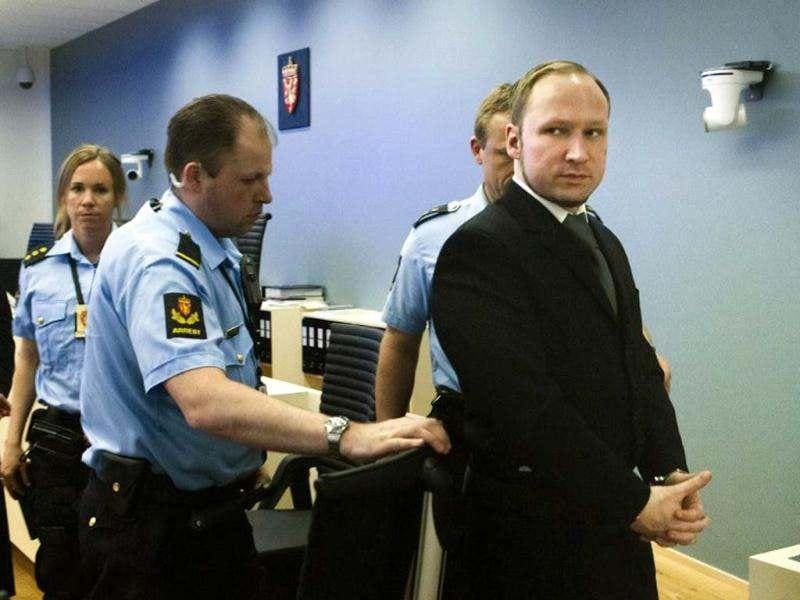 Anders Behring Breivik (R), who had killed 77 people in twin attacks in Norway last year, leaves the court room during his trial as the court hears testimony about the Utoeya massacre. (AFP/Heiko Junge)