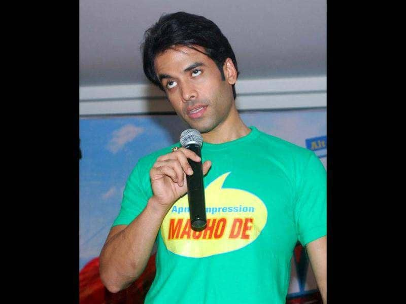Tusshar Kapoor makes a funny face as he interacts with the media during the event. (UNI photo)