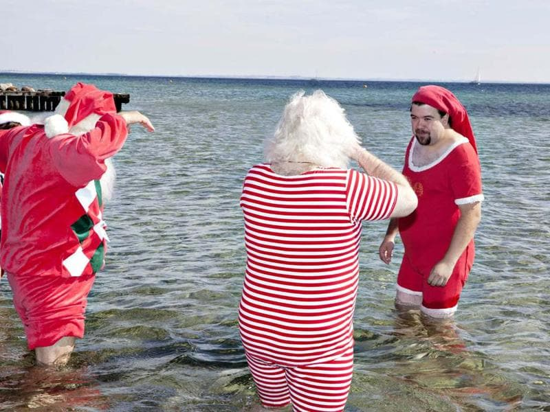 Santas from all parts of the world take part in the traditional foot bath at Bellevue Beach north of Copenhagen. The bath marks the beginning of the annual World Santa Claus Congress. AFP/ Scanpix Denmark