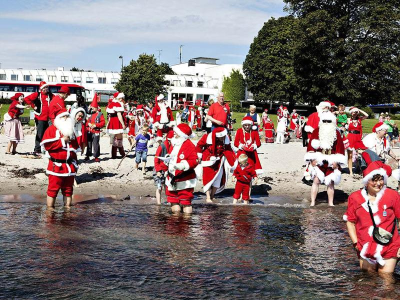 Santas from all parts of the world take part in the traditional foot bath at Bellevue Beach north of Copenhagen. The bath marks the beginning of the annual World Santa Claus Congress. AFP/ Casper Christoffersen