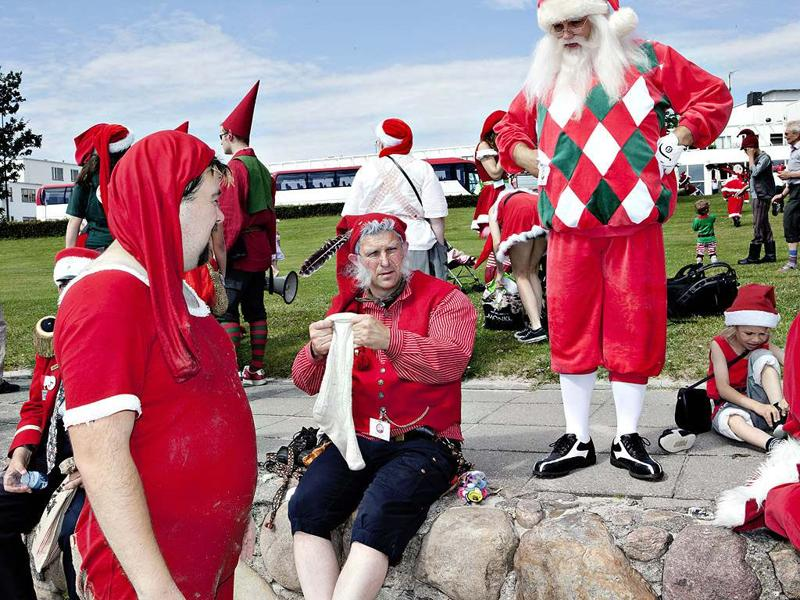 Santas from all parts of the world take part in the traditional foot bath at Bellevue Beach north of Copenhagen, Denmark. The bath marks the beginning of the annual World Santa Claus Congress.