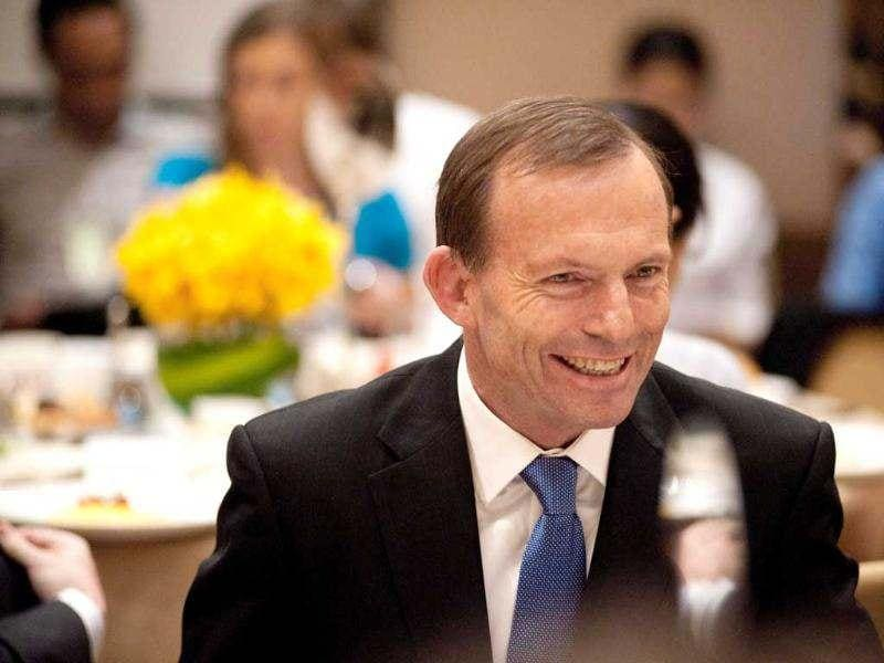 Australian opposition leader Tony Abbott chats with his guests at a breakfast meeting hosted by the China-Australia Chamber of Commerce in Beijing. AFP/Gou Yige