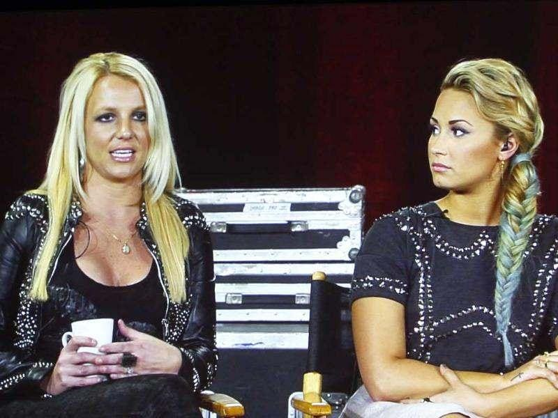 Judges from the reality series The X Factor, Britney Spears (L) and Demi Lovato are pictured during a panel discussion at the Fox television network portion of the Television Critics Association Summer press tour in Beverly Hills, California. Reuters/Fred Prouser