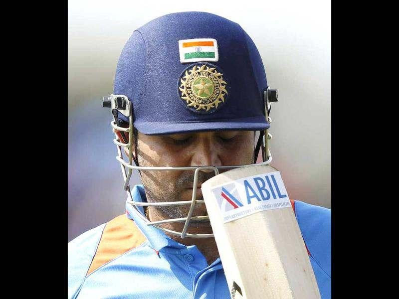 India's Virender Sehwag closes his eyes as he walks off the field after his dismissal during their second one day international (ODI) cricket match against Sri Lanka in Hambantota. Reuters/Dinuka Liyanawatte