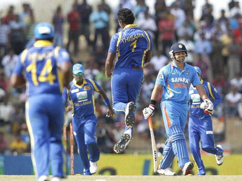 Sri Lanka's Thisara Perera celebrates the wicket of India's Suresh Raina as Raina walks off the field after his dismissal during their second one-day international (ODI) cricket match, in Hambantota. Reuters Photo/Dinuka Liyanawatte