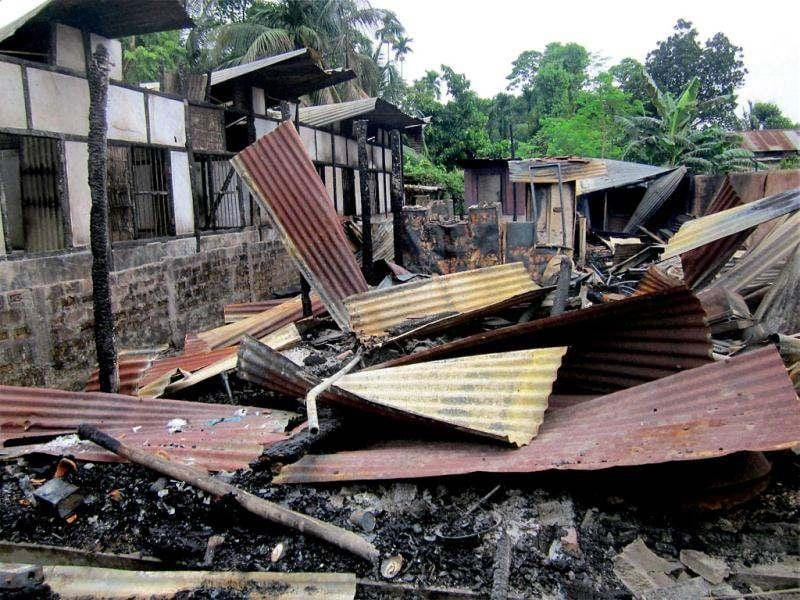 Remains of a house that was burnt during communal clashes in the violence-hit Kokrajhar district. Several villagers have fled their homes after violence near Kokorajhar town. PTI Photo