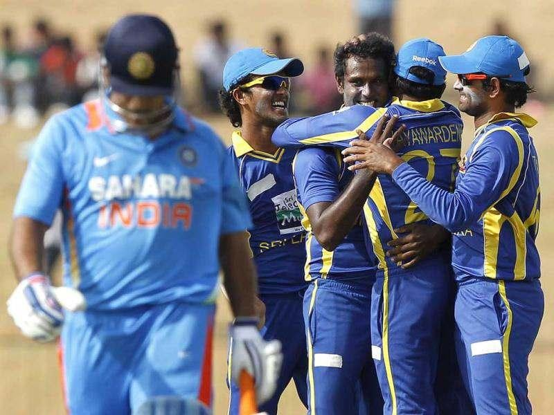 Sri Lanka's Angelo Mathews (3rd L) celebrates with his teammates after taking the wicket of India's captain Mahendra Singh Dhoni during their second one-day international cricket match, in Hambantota. Reuters Photo/Dinuka Liyanawatte