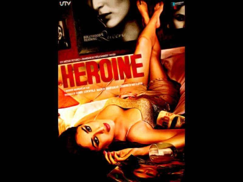 The poster has Kareena dressed in a shimmery tank top and shorts lying down on a bed surrounded by magazines and photos of herself and an empty wine glass.