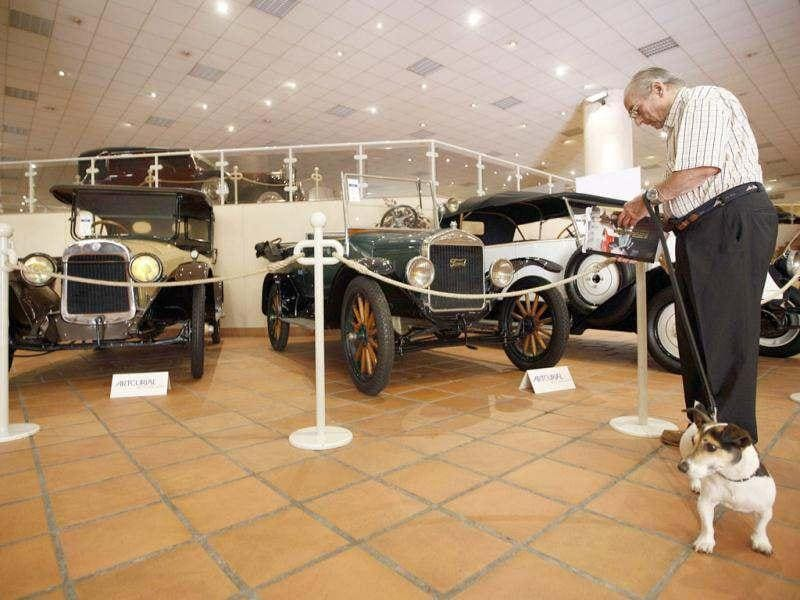 A visitor looks at vintage automobiles from the collection of Prince Albert II of Monaco at the Automobile Museum in Monaco. Thirty-eight cars belonging to Prince Albert II will be auctioned on July 26 in Monaco. Reuters photo/Eric Gaillard