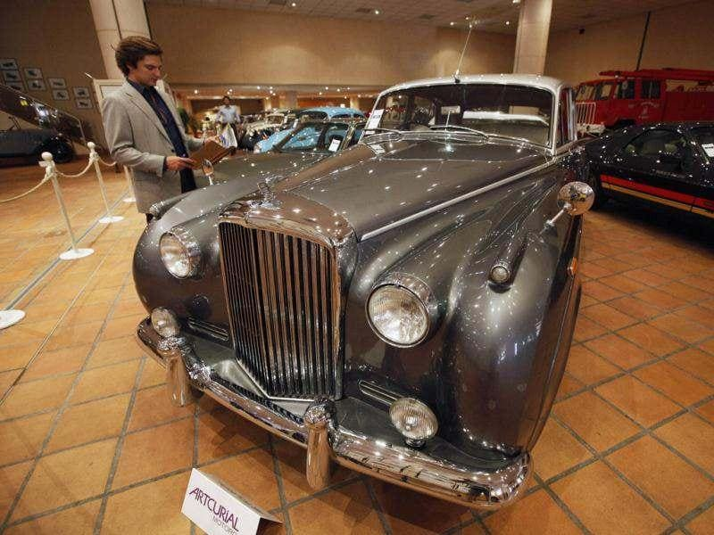 A visitor looks at a Bentley S1 automobile from the collection of Prince Albert II of Monaco which is presented at the Automobile Museum in Monaco. Reuters photo/Eric Gaillard