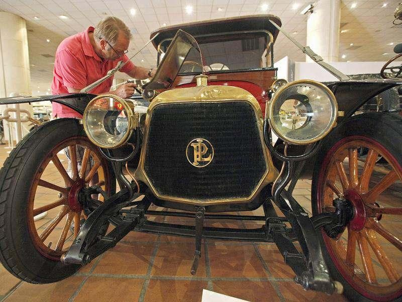 A visitor examines a vintage 1913 Panhard and Levassor X19 roadster automobile from the collection of Prince Albert II of Monaco which is presented at the Automobile Museum in Monaco. Reuters photo/Eric Gaillard