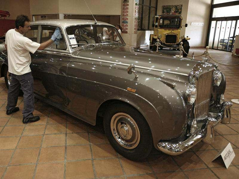 A worker cleans a 1956 Bentley S1 from the collection of Prince Albert II of Monaco at the Automobile Museum in Monaco. AP photo/Lionel Cironneau