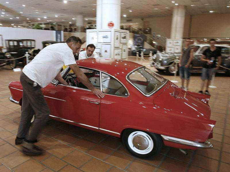 Workers set up a NSU Sport Prinz of 1968 from the collection of Prince Albert II of Monaco at the Automobile Museum in Monaco. AP photo/Lionel Cironneau