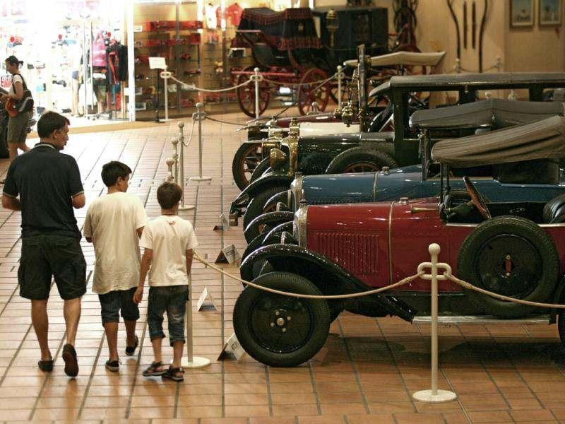 Visitors look at the cars of the collection of Prince Albert II of Monaco at the Automobile Museum in Monaco. AP photo/Lionel Cironneau