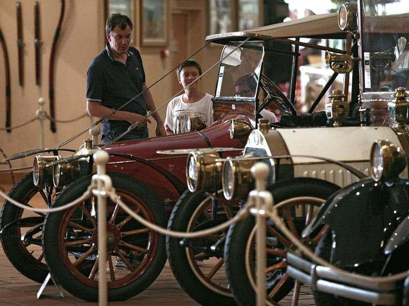 Visitors look at the cars of the collection of Prince Albert II of Monaco at the Automobile Museum in Monaco. Thirty-eight cars belonging to Prince Albert II will be auctioned on July 26 in Monaco. AP photo/Lionel Cironneau