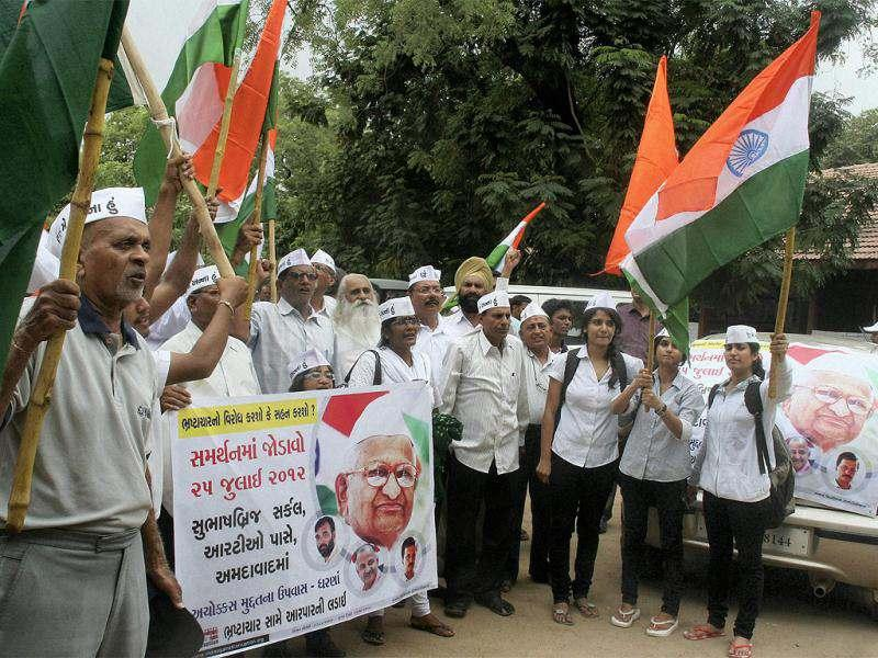 Supporters of Anna Hazare shout slogans during a rally in Ahmedabad. (PTI Photo)