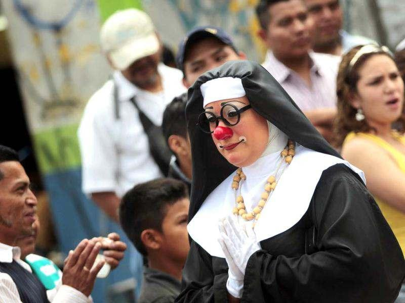 A clown dressed as a nun walks during the inauguration parade of the 4th Latin America clown congress in Guatemala City. Reuters/Jorge Dan Lopez