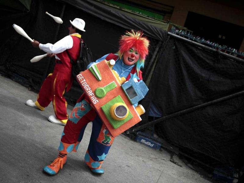 A clown pretends to take a picture with a giant camera in Guatemala City. Reuters/Jorge Dan Lopez
