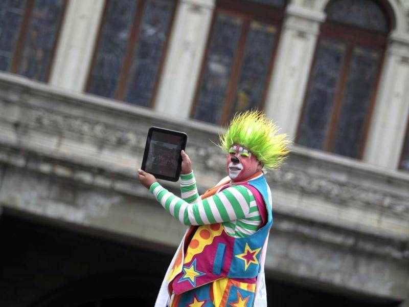 A clown takes a photo with a tablet during the inauguration parade of the 4th Latin America clown congress in Guatemala City. Reuters/Jorge Dan Lopez