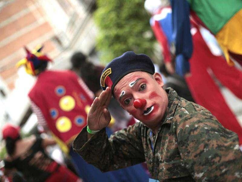 A clown dressed as a soldier salutes during the inauguration parade of the 4th Latin America Clown Congress in Guatemala City. Reuters photo