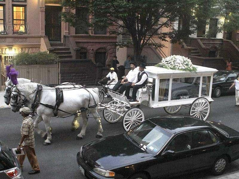 Sylvia Woods' casket is carried in a horse-drawn hearse by her former apartment in New York. Woods, the founder of the famed Harlem soul food restaurant that bears her name, was remembered by famous patrons, neighborhood locals and friends. AP/Fay Abuelgasim