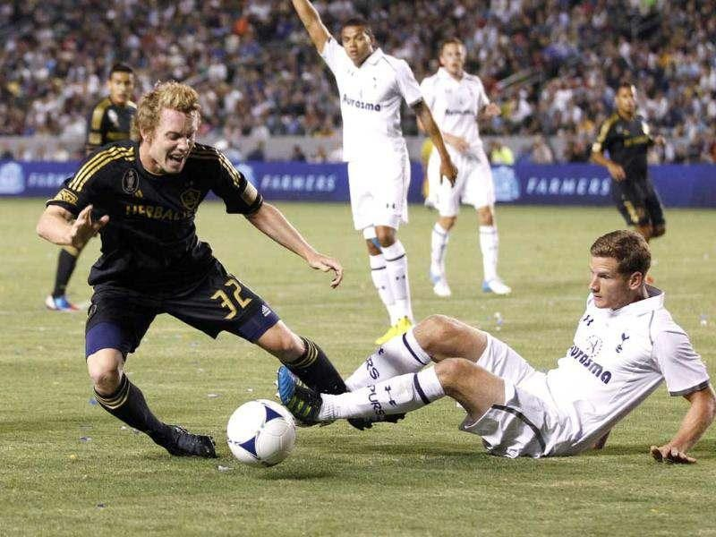 Los Angeles Galaxy's Jack McBean fights for the ball with Tottenham Hotspur's Jan Vertonghen during the second half of an international friendly soccer match in Carson, California. Reuters/Danny Moloshok