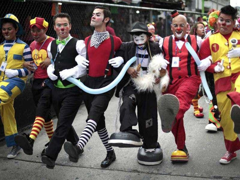 Clowns walk during the inauguration parade of the 4th Latin America Clown Congress in Guatemala City. Reuters/Jorge Dan Lopez