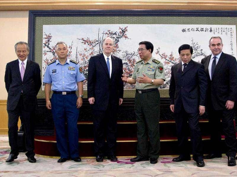 US national security advisor Tom Donilon talks with China central military commission vice chairman General Xu Caihou after a group photo session at the ministry of defense in Beijing, China. AP/Andy Wong