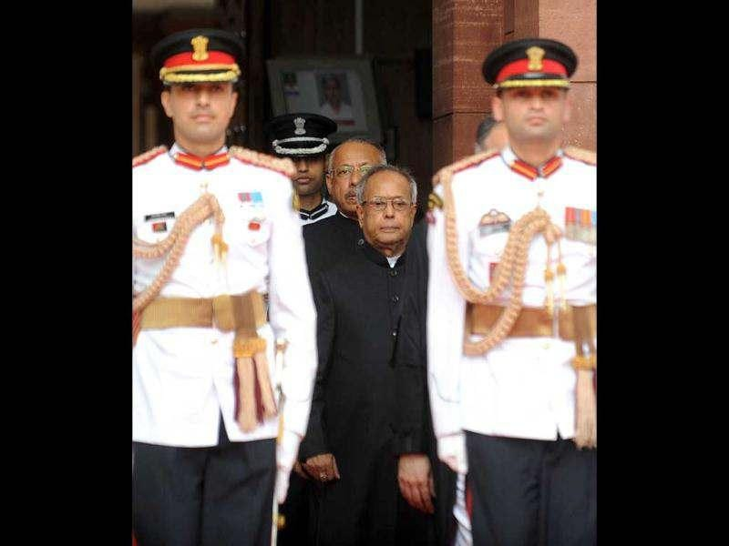 President Pranab Mukherjee (C) is escorted by presidential bodyguards as he arrives for his swearing-in ceremony at Parliament in New Delhi. AFP/Raveendran