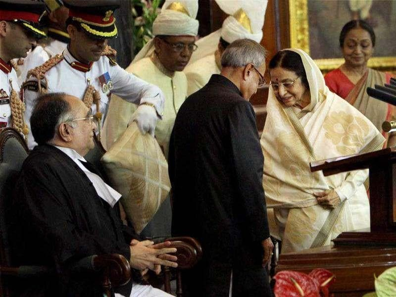 President Pranab Mukherjee and his predecessor Pratibha Patil exchange their chairs after the former took oath as 13th President of India at a special ceremony in the Central Hall of Parliament in New Delhi. PTI/Shahbaz Khan