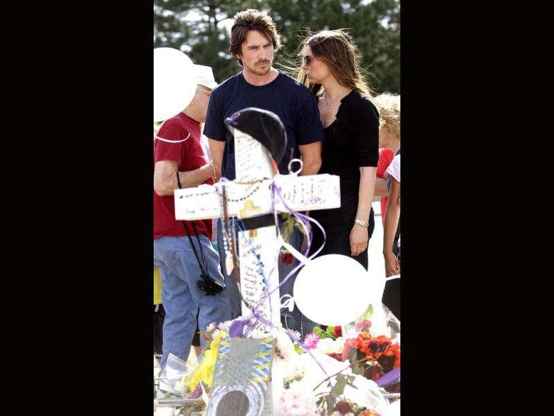 Actor Christian Bale and his wife Sandra Blazic at the memorial across the street from the Century 16 movie theater, where the shooting happened, last Friday.