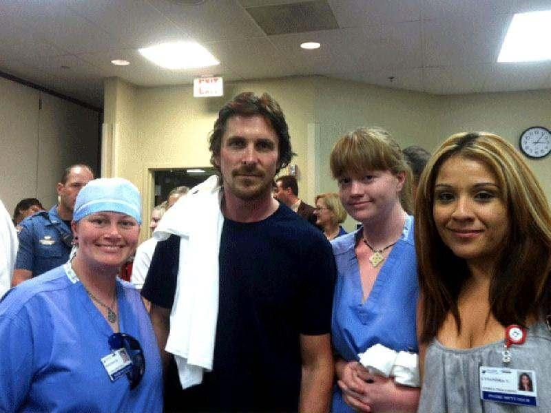Actor Christian Bale, second left, poses with Swedish Medical Center staff at The Medical Center of Aurora, where several victims from the Friday shooting are admitted.