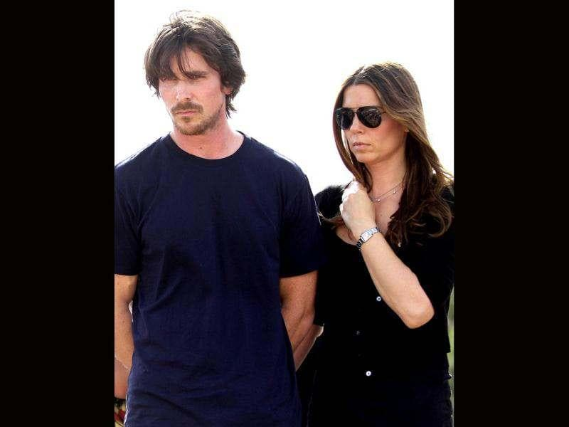 Actor Christian Bale and his wife Sandra Blazic visit the memorial across the street from the Century 16 movie theater. The memorial was created for the victims of the mass shooting that occured at the theater last Friday.