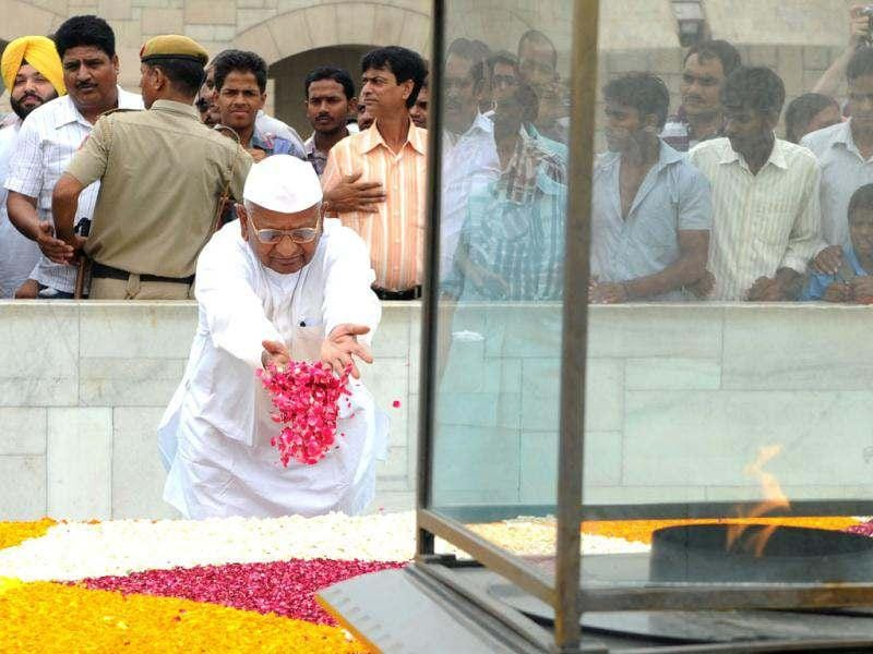 Anti-corruption activist Anna Hazare pays his respect at Rajghat, the memorial of Mahatma Gandhi in New Delhi. Campaigning for a strong Lokpal Bill, close aides of anti-corruption activist Anna Hazare have started an indefinite fast to protest against the government. AFP Photo/Sajjad Hussain