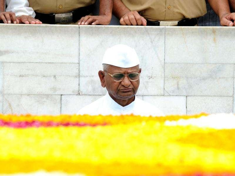 Anti-corruption activist Anna Hazare pays homage at Rajghat, the memorial of Mahatma Gandhi in New Delhi. Campaigning for a strong Lokpal Bill, close aides of anti-corruption activist Anna Hazare have started an indefinite fast to protest against the government. AFP Photo/Sajjad Hussain