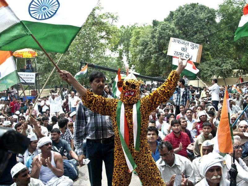 Supporters of anti-corruption activist Anna Hazare shout slogans during a protest in New Delhi. AFP/ Rahul Singh