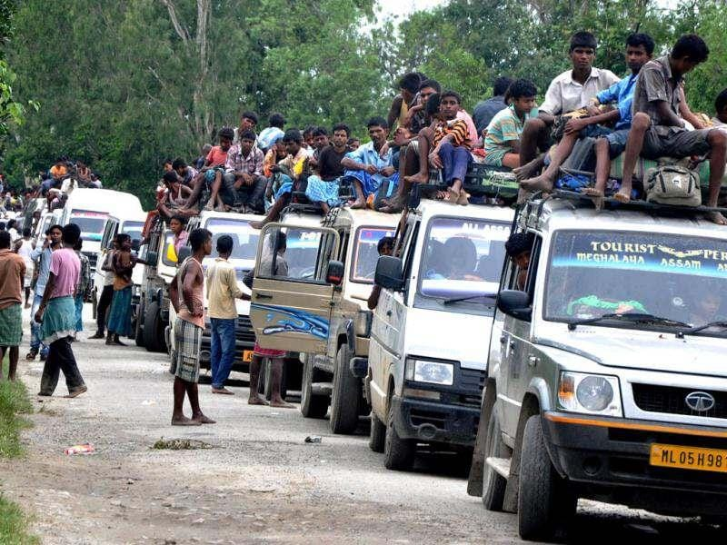 Villagers flee their homes at Dujabari village in Kokrajhar district, about 230 kms from Guwahati, the capital city of the northeastern state of Assam. AFP Photo