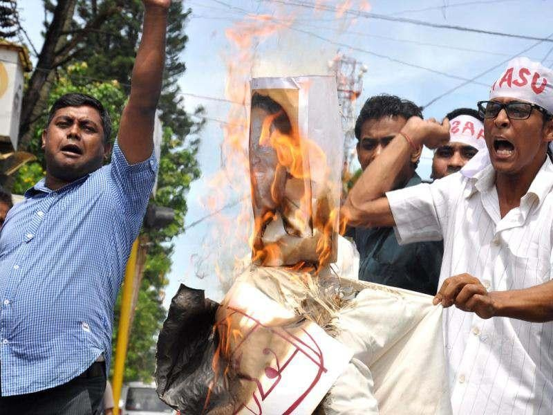 Members of All Assam Students Union (AASU) burning effigy of chief minister Tarun Gogoi, protesting the government's failure to control violence in lower Assam districts, in Guwahati. Agencies
