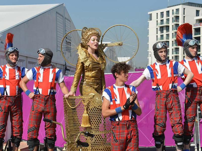 Dancers perform during an arrival ceremony for athletes at the Olympic Village in London, two days before the start of the London 2012 Olympic Games. AFP/Adek Berry